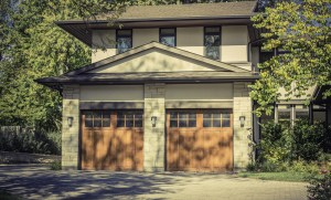 Garage Remodel with 2 Single Car Overhead Doors and Stone and Stucco Exterior