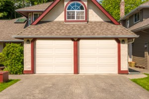 Garage with ADU Remodel with Cream Stucco, Red Trim and 2 Single Car Overhead Doors