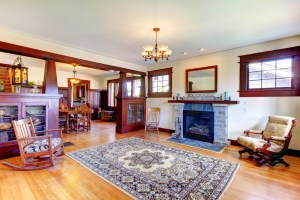 Interior Remodel with Fireplace and Stained Woodwork throughout the Living Room and Dining Room