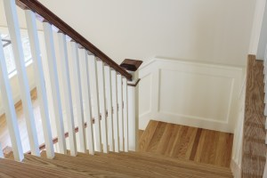 Interior Remodel with Wood Stairs, Painted Balusters and Stained Top Rail