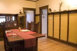 Interior Remodel Dining Room with Stained Wood Battens, Top Rail and Painted Embossed Panels Between