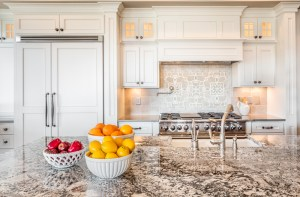 Kitchen Remodel with Classic Painted White Cabinets, Granite Countertop, Full Height Marble Tiled Backsplash, Farmhouse Sink and Built-In Fridge