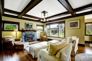 Whole House Remodel with Living Room, Fireplace with Stone Surround, Wood Flooring and Decorative Stained Wood Beams at Ceiling
