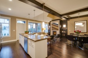 Whole House Remodel with Kitchen in open floor plan with Dining Room and Living Room, including Painted White Cabinets, Engineered Stone Countertops and Stained Wood Beams