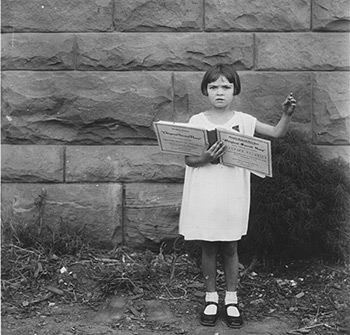 "Lorraine Miles, age six, led ""The Last Words of Copernicus"" (p. 112 in The Sacred Harp) to win a gold piece in a children's singing contest at the 1930 Sacred Harp Singing Convention in Mineral Wells, Texas."