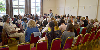 More than 140 singers registered for the 2012 UK Convention: a record turnout. Here Robert Wedgbury leads the class. Photograph by Ewan Paterson.