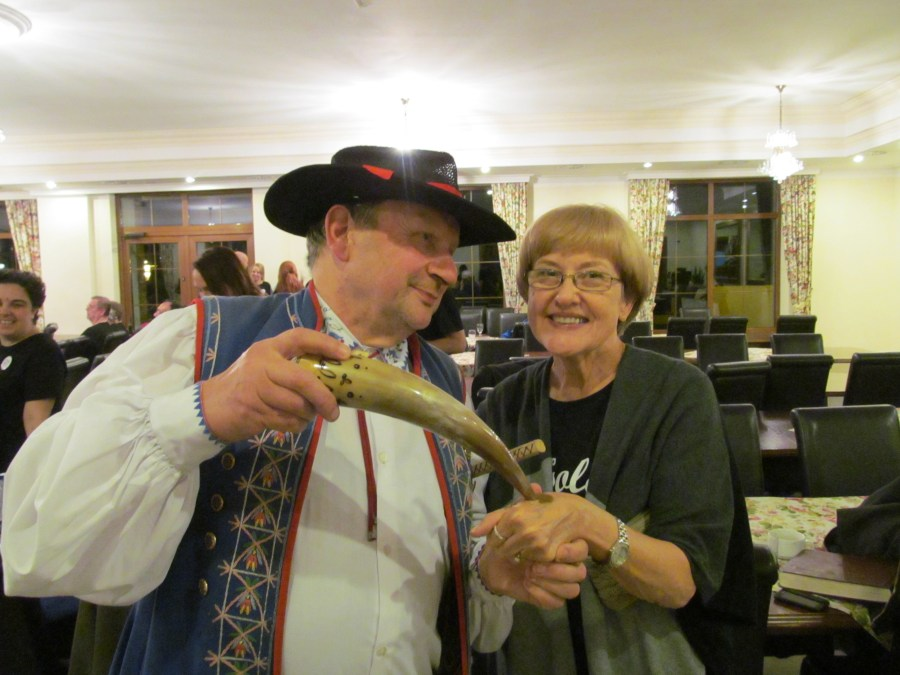 The Kashubian folk dance troupe's ringleader shares snuff with tour group member Linda Thomas. Photograph courtesy of Linda Thomas.