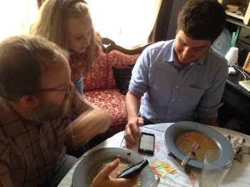 Matt Hinton, Anna Hinton and Mark Godfrey consult the app.