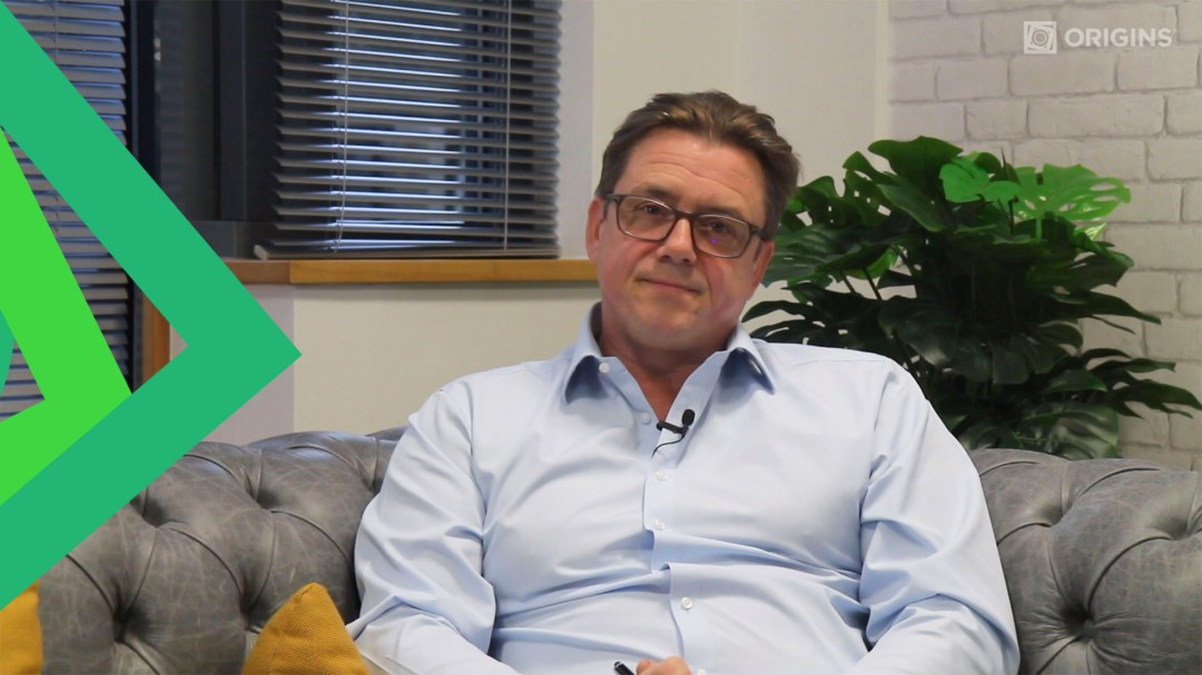 David Youds, Founder and CEO of Bedrock Group, sitting down on a sofa