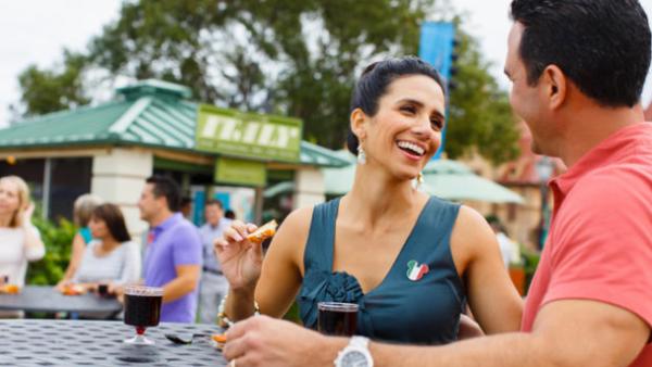 Epcot Food and Wine Festival: image of woman eating and drinking at Epcot