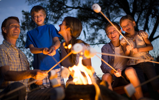 Orlando free things to do: image of family roasting marshmallows at Disney's Fort Wilderness.