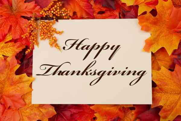 Thanksgiving restaurants: Happy Thanksgiving graphic with fall leaves