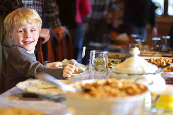 Thanksgiving Orlando: image of child eating a Thanksgiving dinner