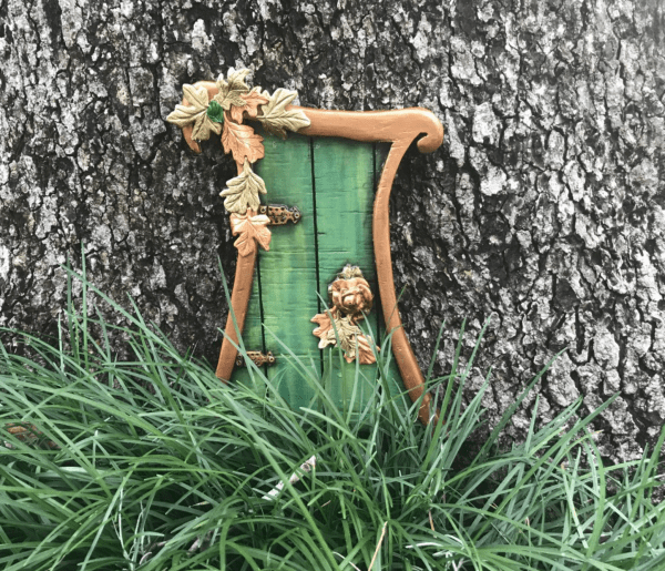 Things to do this weekend: image of a Fairy Door on a tree at Leu Gardens in Orlando