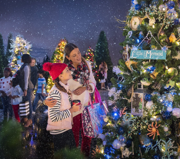 Things to do this weekend in Orlando: image of a mom and daughter looking at Christmas tree at Disney Springs