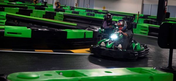 Andretti Indoor Karting & Games: image of person driving kart indoors at Andretti