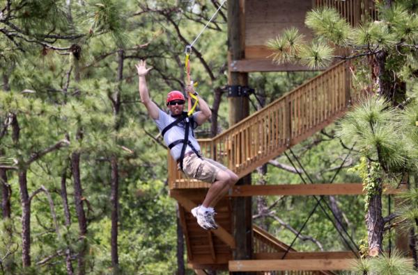 Gatorland Orlando deals: image of man flying through Gatorland Orlando on a zipline
