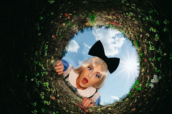 "Things to do in Orlando: image of Alice from Alice and Wonderland at the new ""Down the Rabbit Hole"" immersive experience at Mead Botanical Garden in Winter Park"