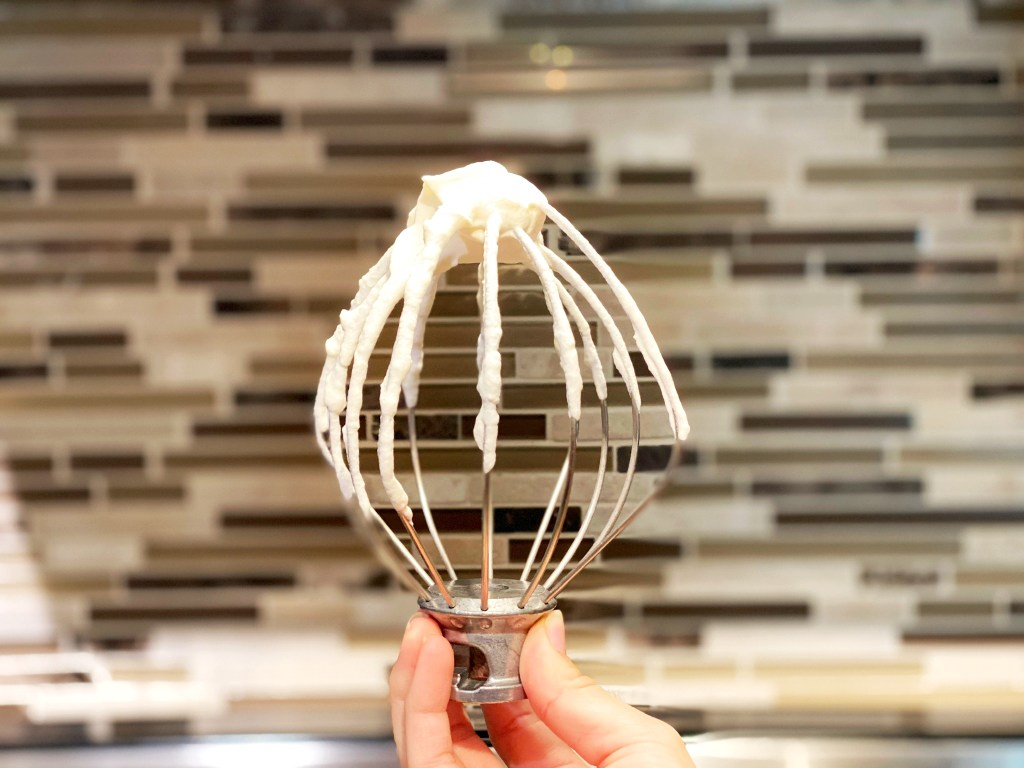whipped cream on whire whisk