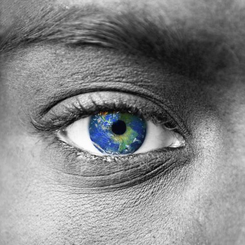 Planet earth in blue human eye