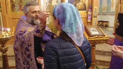 Archpriest Vitaly Serapinas anoints the faithful, 2019