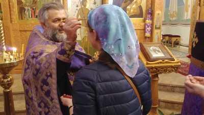 Archpriest Vitaly Serapinas anoints the faithful, 2019