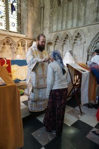 The faithful venerate the Cross
