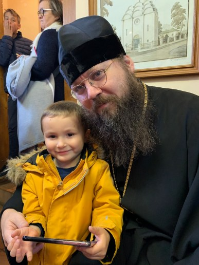 Bishop Irenei visits with a young parishioner of the Memorial Church in Brussels