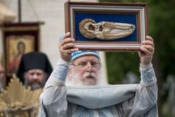 Archimandrite Luke holding an icon of the Dormition of the Most Holy Theotokos