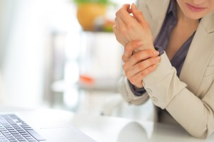 businesswoman with wrist pain