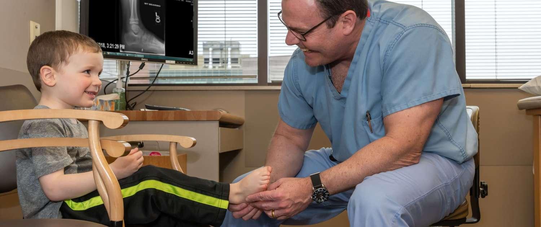 Child undergoing foot examination at Orthopedic Institute