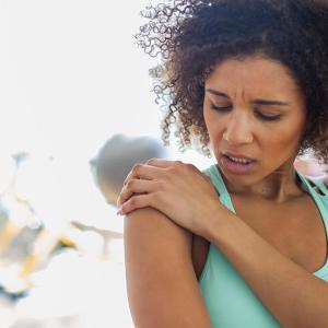 Woman in pain from shoulder instability or a labral tear