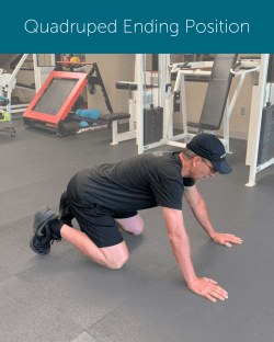 Orthopedic Institute Spine Therapist demonstrates the ending position of a quadruped hip hinge modification.