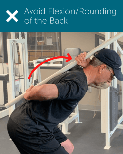 Orthopedic Institute Spine Therapist demonstrates lack of a neutral spine or flexion/rounding of the back.