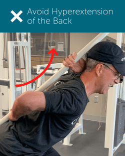 Orthopedic Institute Spine Therapist demonstrates bad posture or hypertension of the back.