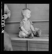 """Tulare County, California. In Farm Security Administration (FSA) camp for migratory workers. Baby with club feet wearing homemade splints inside shoes."" Dorothea Lange"""