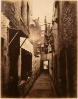 Thomas Annan Plate 10- Close, No. 101 High Street. Damp trousers hang motionless while dry clothes are moved by a breeze during an exposure