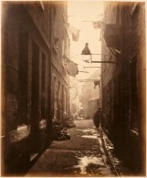 Thomas Annan Plate 13- Close, No. 80 High Street. Children loiter in an alley close to an overflowing gutter