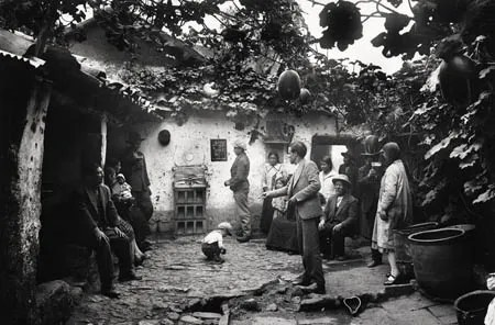 Playing 'Sapo', Chicheria on Pumacurco Street, Cuzco, 1932.