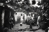 Playing 'Sapo', Chicheria on Pumacurco Street, Cuzco, 1932.