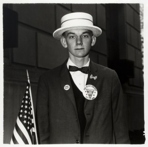 diane-arbus-boy-with-a-straw-hat-waiting-to-march-in-a-pro-war-parade-n-y-c-1967