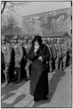 CHINA. Beijing. December 1948. A bewildered old man searches for his son as the new recruits called up by the fast-weakening Kuomintang government march off to defeat.