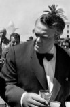 FRANCE. 11th Cannes film festival. 1958. American film director Orson WELLES at a cocktail.