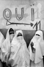 """ALGERIA. Algiers. The conflict with France and Algeria has lasted for 8 years, splitting the French Colonial powers who wanted to retain an """"Algerie Francaise"""" and the local population led by the FLN (National Liberation Front) who demanded independence. Veiled women going to the voting stations for the Independence referendum. July 1962."""
