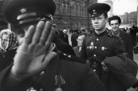 Young Soviet officers having just reached Red Square to watch parade. First officer refused to have his picture taken. The second one said he was proud to have his picture taken.