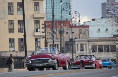 Fashion models are driven in vintage American convertible cars along the Malecon to take part in the Chanel fashion show in Havana, Cuba, Tuesday, May 3, 2016. (Photo by Desmond Boylan/AP Photo)