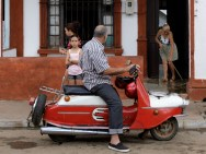 A man sits on his Czech-made 1962 model CZ 502 scooter in the village of Artemisa, west of Havana, February 6, 2010. (Photo by Desmond Boylan/Reuters)