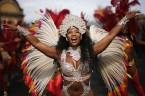 Costumed revellers perform in the parade during the Notting Hill Carnival in London, Monday, Aug. 27, 2018. The carnival has been held every year since 1966 and one of the largest festival celebrations of its kind in Europe. (AP Photo/Tim Ireland)