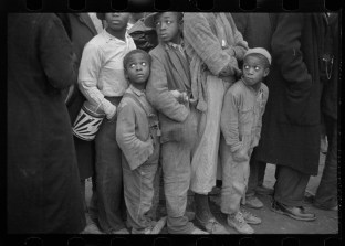 Negroes in the lineup for food at mealtime in the camp for flood refugees, Forrest City, Arkansas walker evans 3