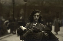 Woman carrying a child in Central Park, NYC 1956